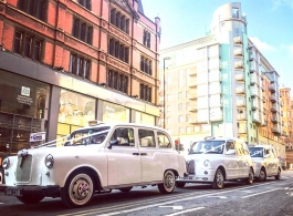Classic London taxi for weddings in Altrincham